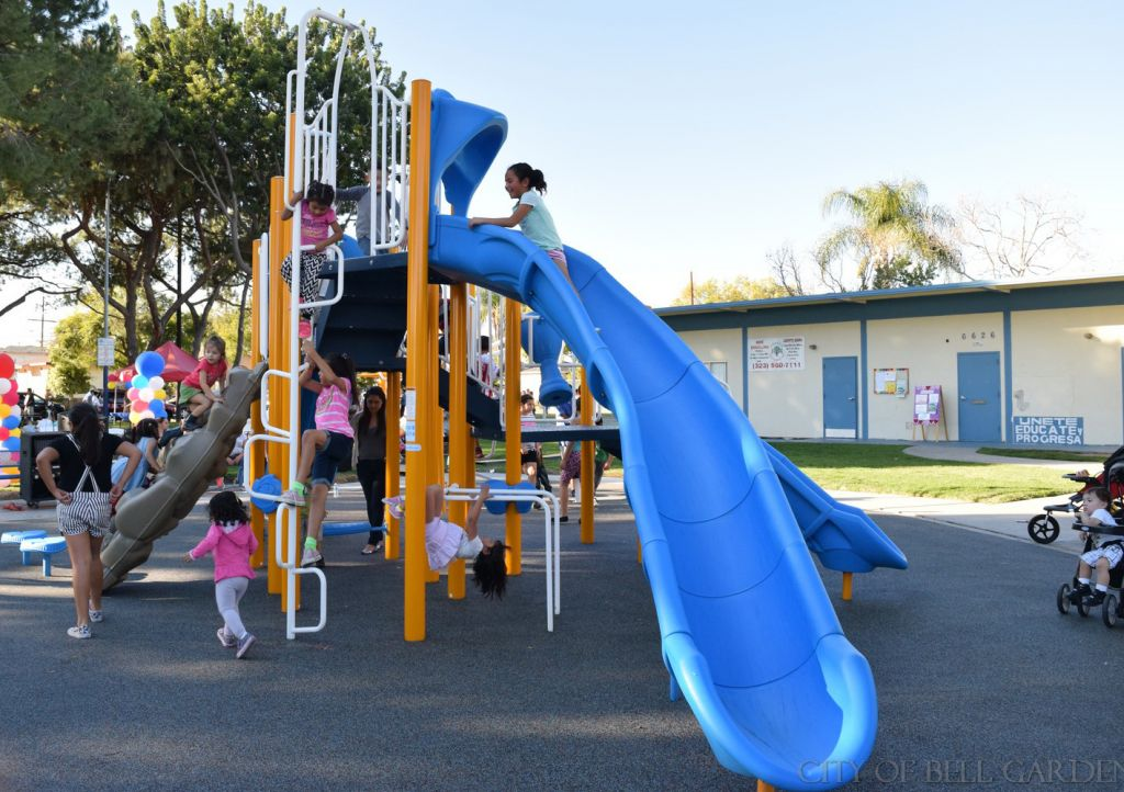 A large plastic slide is one of the best features of Bell Gardens' new playground.