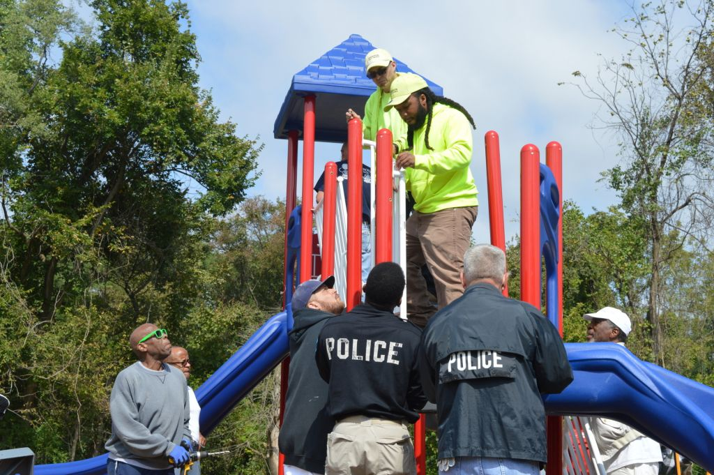 Police-and-workder-building-playground.JPG#asset:413