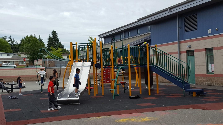 Elementary School Playground with Metal Slides | Sitelines